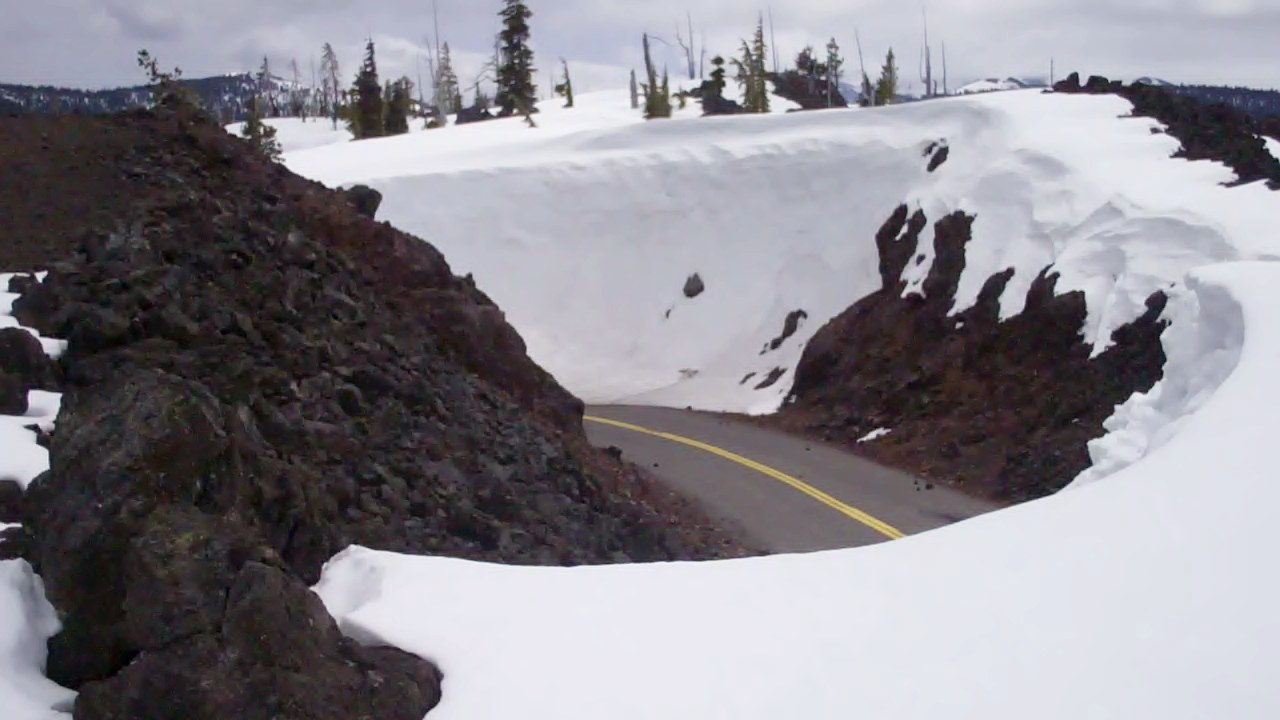 Snow_drifts_on_McKenzie_Pass_Highway_(5707598348)